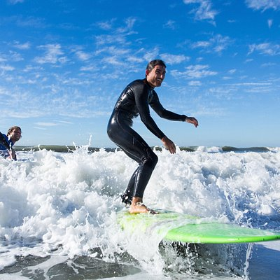 standing up on a wave during your first ever surf lesson - can't beat the feeling!
