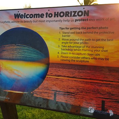 Sign about the artwork Horizon, or AKA the big marble.