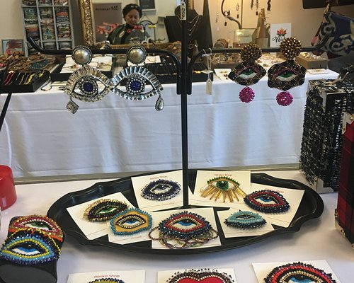 Hand embroidered brooches and earrings.