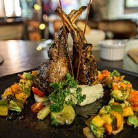 Flambé Rack of Lamb with vegetables and mashed potatos. Truly delicious!
