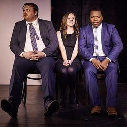 Trevor Livingston, Vicki Hanes, and Christian Robers of the Main Stage cast at Improv Asylum.