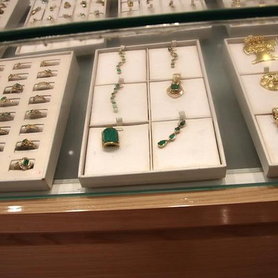 Emeralds set in gold and silver settings