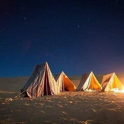 Sleep on sand dunes under stars