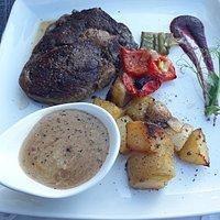 Before and after , fantastic rib eye steak .