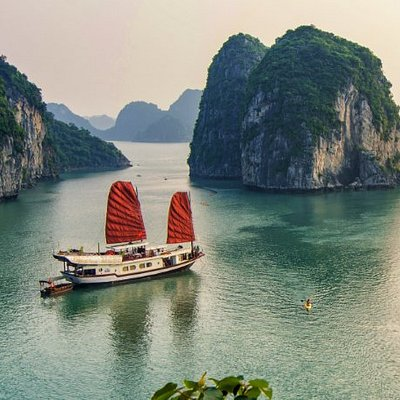 The boutique wooden boat of Indochina Junk sailing in Bai Tu Long Bay