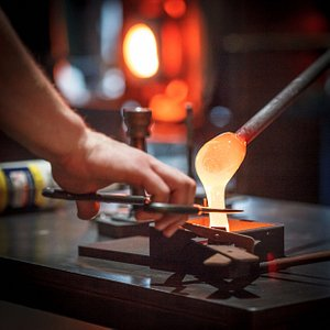 Pouring molten glass into a mold. It has the consistency of honey.