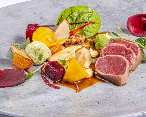 Saddle of venison with beetroots, ginger, spinach and stuffed mushroom