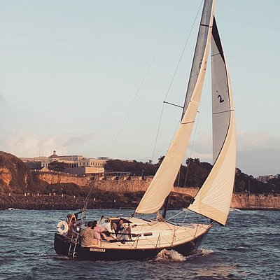 Morcilla, one of our J30 sailboat sailing smoothly sporty by St.Felipe del Morro