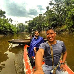 Canoeing down an Amazon Rainforest river