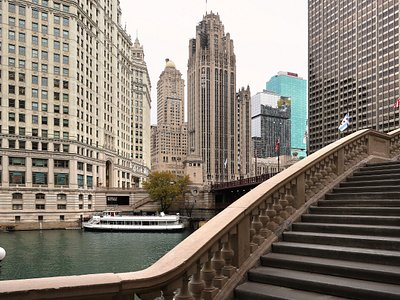 The Chicago Riverwalk - A Pathway Along the Chicago River, Roughly Parallel to Wacker Drive - Starts at the Riverwalk Gateway Tunnel Under Lakeshore Drive, and Runs for Several Miles w/ Parks, Museums, Historical Landmarks, Restaurants/Bars, Attractions, Art Installations and Lighted Passages Below the Famous Bridges Over the Chicago River. Broken in Spots (North Bank of the River), it is Accessible From Various Stairs Down From Street Level