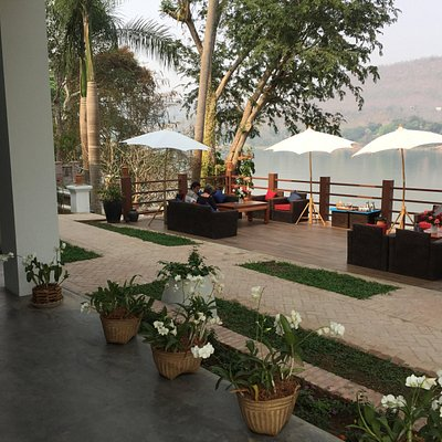 The beautiful terrace of the center directly at the Mekong. A place to relax and have your worried taken away by the river.