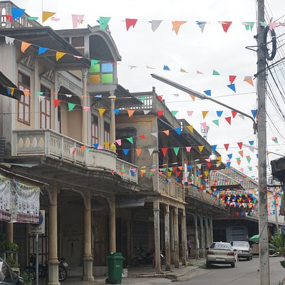 Street with old buildings in Tha Muang