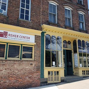 Storefront windows of the Reher Center,
