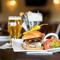 Come enjoy a bacon cheese burger from our pub menu.