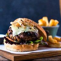 Monster Burger, spicy aïoli, onion marmalade, Healey's cheddar, sesame bun.  A Jan Cats classic since 1989.