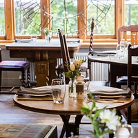 The downstairs restaurant, with beautiful views over the common.