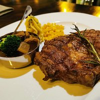 Medium Rib Eye 250g - 20USD, with a side of slow-cooked beef, broccoli, sweetcorn and parsnip puree.