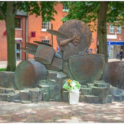 One side of the John Bonham Memorial Statue in Redditch town centre.