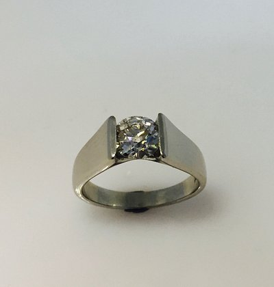 A family heirloom diamond that has been passed through the generations and now been set into this platinum ring so it can continue to reflect the light in a way that only diamonds can.