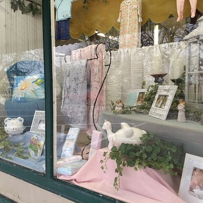 Another street-facing window display at The Giving Tree in Highland, IL