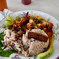 Tropical shrimp with rice & beans, fried plantain, cole slaw & avocado