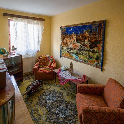 "Livingroom of the Museum, decorated with ""Răpirea din Serai"" rug (""The abduction from the Caravanserai""), a highly desired item in every workingman home in communism era."