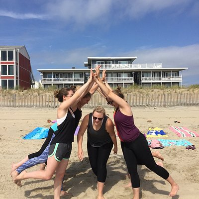SUP Yoga on the Bay! Beach Yoga at Dickinson Street! Bachelorette yoga and rose quartz hearts!  A picture of quartz crystals that everyone received at one of our full moon yoga sessions. Pictures of drums and bonfires that are always at full moon yoga!