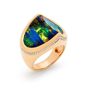 Sieto Colores ring designed by Renata Bernard. This unique and delightful boulder opal from Winton, set in 18K rose gold, adorned with 64 diamonds.