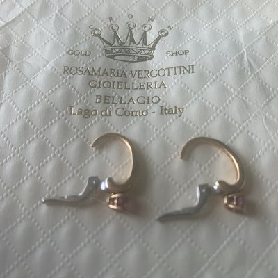 gold earrings with diamonds and hanging pink stone
