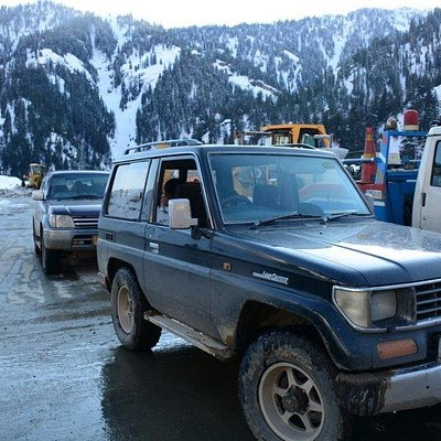Our two battered Toyotas, just before Lowari Tunnel, waiting for the oncoming traffic to pass. Lowari is one-way tunnel.
