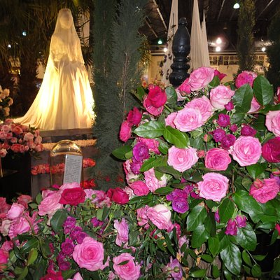 Replica of Princess Grace wedding gown, presented at Philadelphia Flower Show 2020-with Princess Grace Roses in foreground.