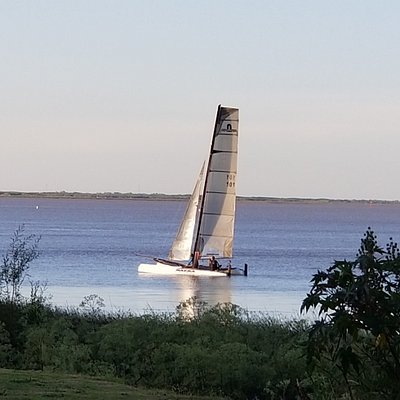 Sailboats just off the coast, at Agula Grande Fuera del Tiempo Park, in San Isidro (Buenos Aires) Argentina.