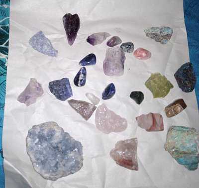A variety of rocks, both polished and natural -- quartz, amethyst, celestite, sodalite, amazonite, painted desert, and several others.