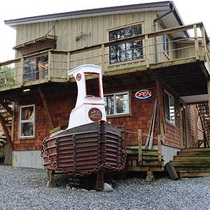 Telegraph Cove Art Gallery is located at the entrance to the Cove. A unique must see gallery where unique local art is found inside and outside.  Come have your picture taken on the Boom Boat Mascot! Open daily May to September.  Open by chance the remainder of the year.