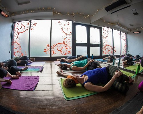 A reclined twist would be held for 3-5 minutes in a Yin class to allow your body to soften and open it it's own time.
