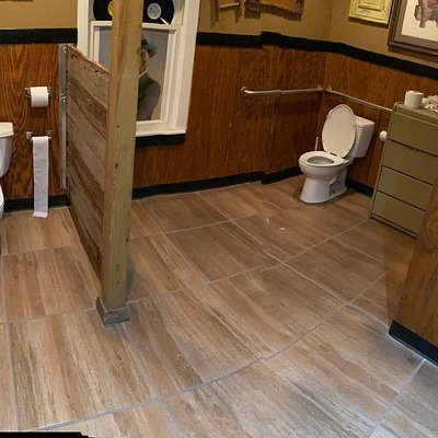 *Please not this review is based solely on the restroom*  While this restroom could have been cleaner, I was visiting on a Saturday which is presumably their busiest time   👍 Spacious 👍 PULL door, but paper towel is provided  👎Very odd bathroom set-up
