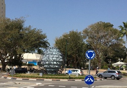 The circle in front of the shopping center.