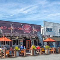 Located on the sunny side of Revell Street with outdoor seating.