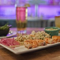 Spicy Habanero Shrimp Skewer  Best Aquacultures Practices Certified prawns in habanero marinade. Served with avocado dip & cabbage salad.