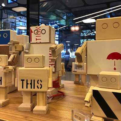 Cool robots made from wood. I Amsterdam Store, Central Station.