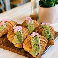 Fresh croissants with green matcha royal icing and rose water fairy floss.