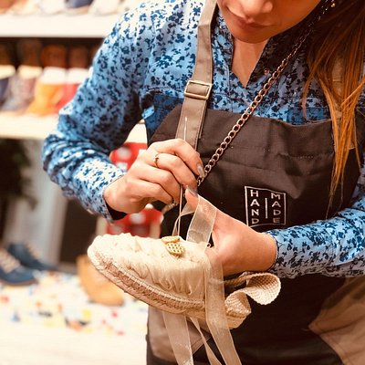 Our artisan making a custom-made espadrilles for a wedding