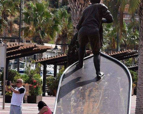 Fisherman statue on the Plaza Comunidades Autonomas