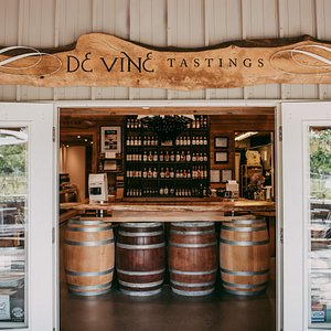 Welcome to our cozy tasting room. It's barrels of fun in there;)