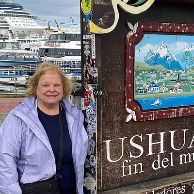 My wife poses with the popular End of the World sign near the cruise ship pier in downtown Ushuaia. (AlpinerHut)