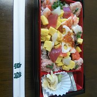 Chirashi zushi - rice topped with sashimi and other ingredients  Looks nice and yummy!