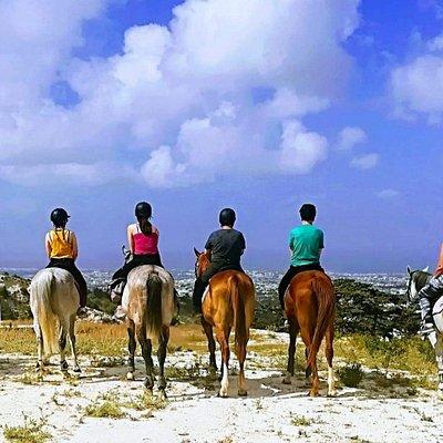 Morning horseback riding enjoying the sunshine and Paphos view