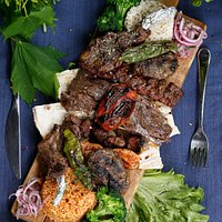 Mixed Grill - Exclusive Doner, lamb sis, adana kebab, meat balls, chicken sis served with rice pilaf and salad.
