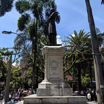 Side view of Statue in the center of Parque Berrio.