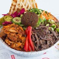 THE ISTANBOWL Rice, Beef & Chicken Döner Kebab, Red Cabbage, Onions, Parsley, Shepherd's Salad, Falafel & Pita Bread.